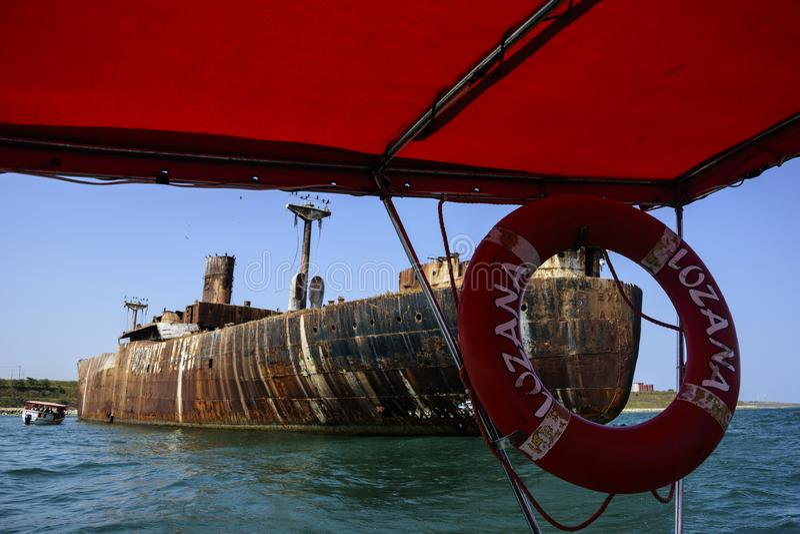 Visiting the famous abandoned shipwreck near Costinesti, Romania. COSTINESTI, ROMANIA - AUGUST 30, 2018. Boat trip with L`Ozana, visiting the famous abandoned royalty free stock image