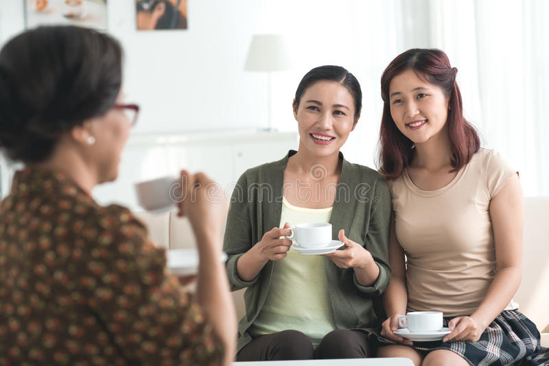 Visiting grandmother. Vietnamese middle-aged women and her daughter visiting grandmother stock photography