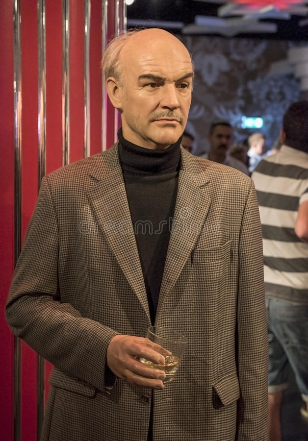 Visiting Madame Tussaud's museum. Sean Connery wax figures in Madame Tussaud's museum. London royalty free stock image