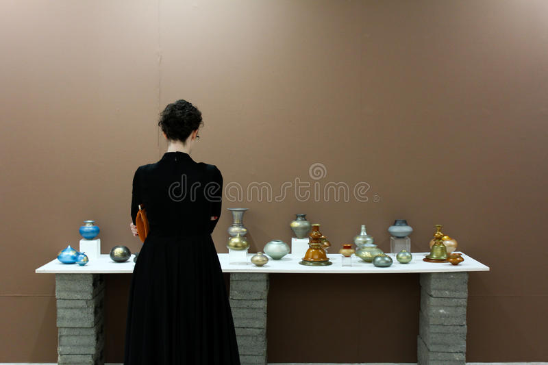 Visitor at art exhibition. At V. M. Art Gallery, Karachi, Pakistan. Photo taken during and art exhibition Fourth Asna Clay Triennial Exhibition will continue royalty free stock image