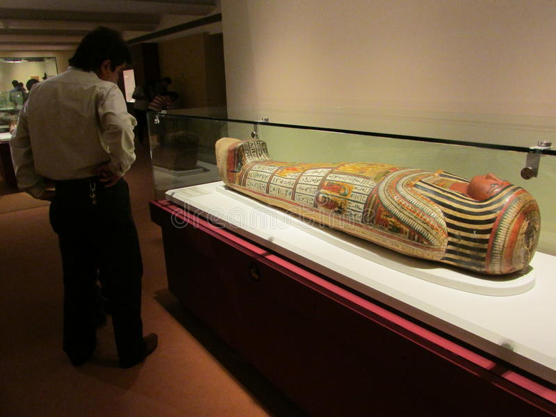 A visitor at the coffin of Nesperennub royalty free stock photo