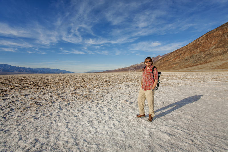 Visitor inthe Death Valley. Visitor at the Badwater Basin slat flats Death Valley stock image