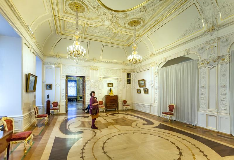 Visitor in room of Marble Palace in St Petersburg royalty free stock photo