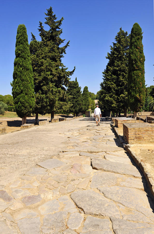 Visitor walking at the Cardus Maximus, archaeological site of the Roman city of Italica, Andalusia, Spain stock photos