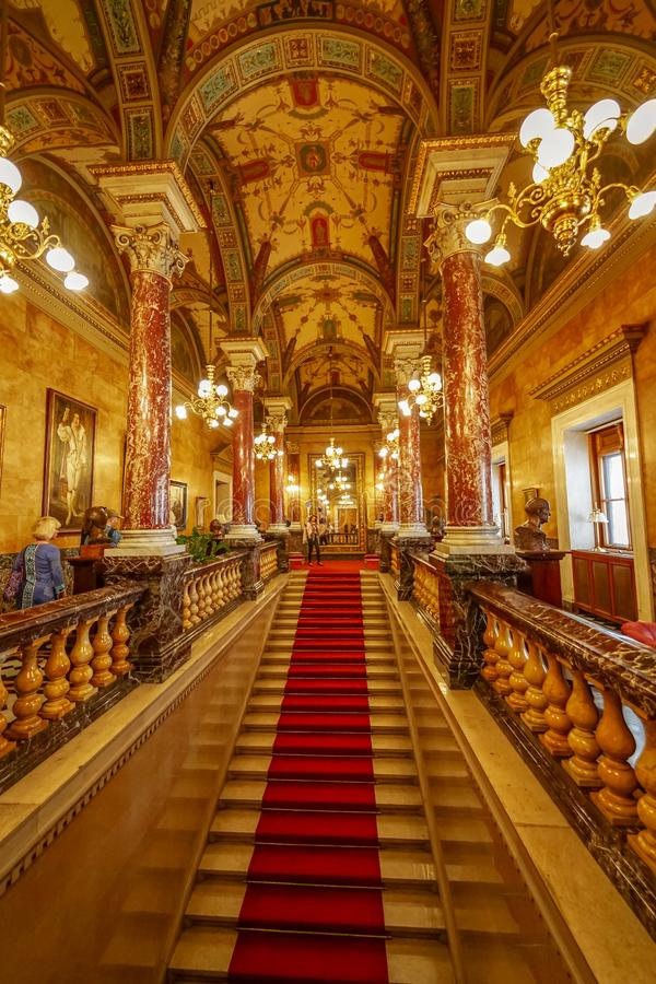 Visitors admire Budapest opera architecture. Baroque architecture and red carpet for Budapest opera. Guided tours in many languages stock images