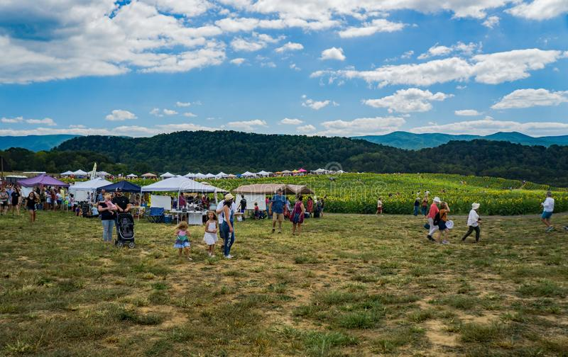 Visitors at the Annual Sunflower Festival. Botetourt County, VA, September 7th: Visitors to the annual Sunflower Festival located at Beaver Dam Farm in Botetourt stock image