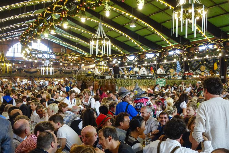 Oktoberfest beer festival in Munich, Germany. Visitors in a beer tent at the Oktoberfest in Munich, Bavaria, Germany, Europe stock photography