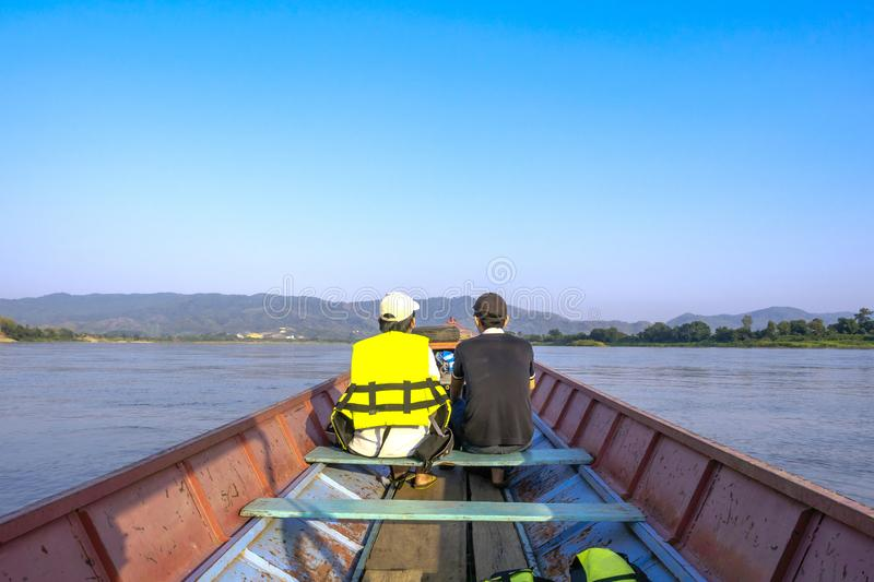 Visitors can take a small boat to see the nature along the Mekong River. royalty free stock images