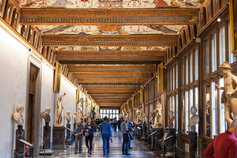 Visitors in Eastern corridor of Uffizi Gallery stock photos
