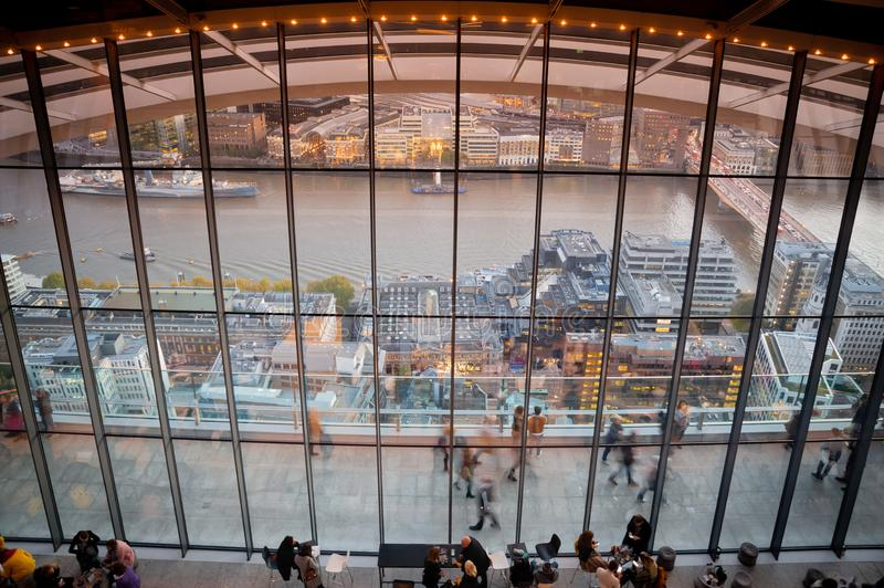London, UK. 03-11-2018. Visitors enjoiying view from Sky Garden Terraces at south London with busy Thames River. royalty free stock images