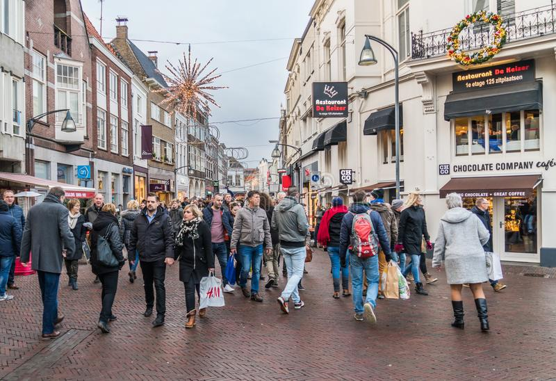 Visitors entering and leaving the main shopping street in the old town royalty free stock photos