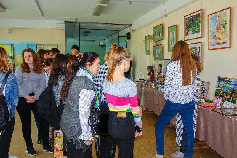 Visitors at the Exhibition of works by students at the College of the city of Chapaevsk stock image