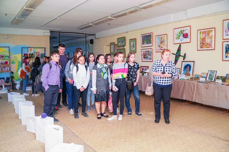 Visitors at the Exhibition of works by students at the College of the city of Chapaevsk royalty free stock photo