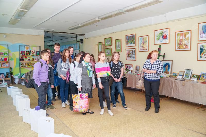Visitors at the Exhibition of works by students at the College of the city of Chapaevsk royalty free stock image