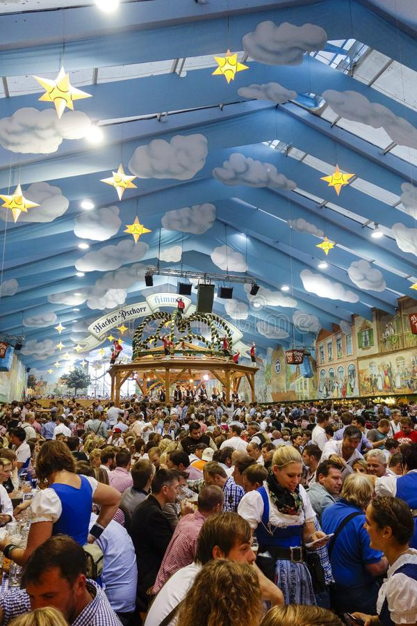 Oktoberfest beer festival in Munich, Germany. Visitors in the Hacker-Pschorr Beer tent at the Oktoberfest in Munich, Bavaria, Germany, Europe royalty free stock images