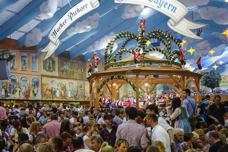 Oktoberfest beer festival in Munich, Germany. Visitors in the Hacker-Pschorr Beer tent at the Oktoberfest in Munich, Bavaria, Germany, Europe stock photography