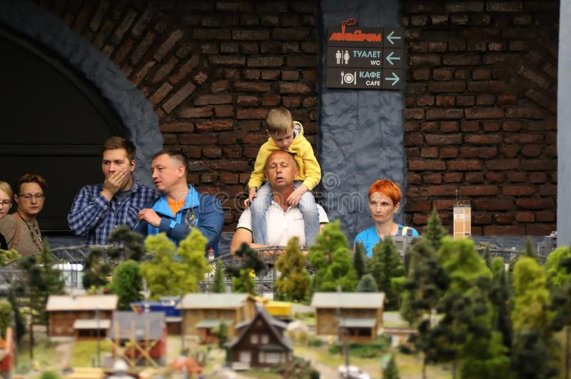 Visitors are looking at the layout. Collective image of cities and regions of the Russian Federation, made in miniature. National show-museum `Grand layout stock images