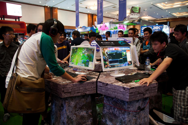Visitors Playing Video Games at Indo Game Show 2013 stock images