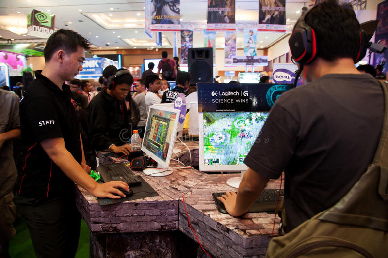 Visitors Playing Video Games At Indo Game Show 2013 Editorial Stock Photo