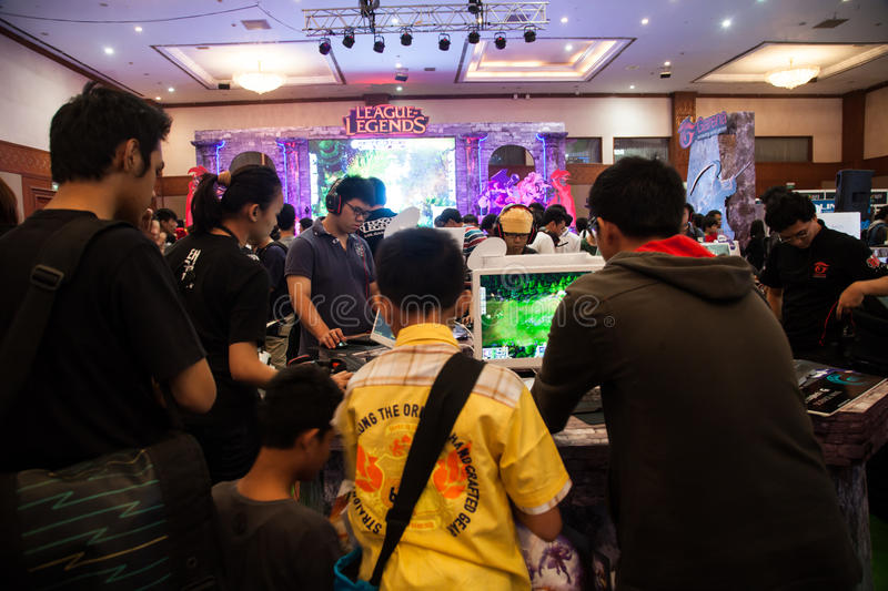 Visitors Playing Video Games at Indo Game Show 2013. Jakarta, Indonesia, 8th September 2013: Several visitors playing video games on one of the stands at Indo royalty free stock images
