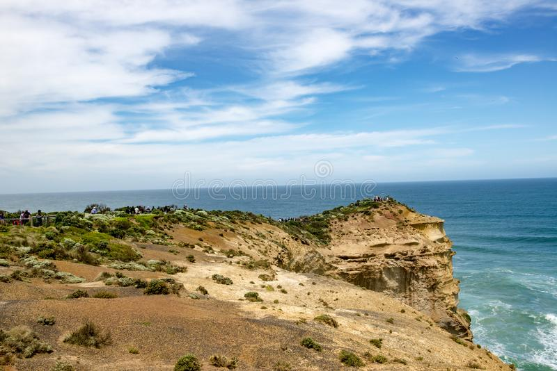 Visitors on rockbound coast, Twelve Apostles, Australia stock photography