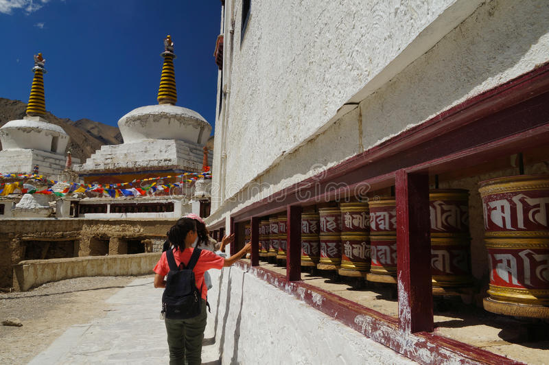 Visitors rotating praying wheel at Lamayuru Monastery in Ladakh, India stock photo