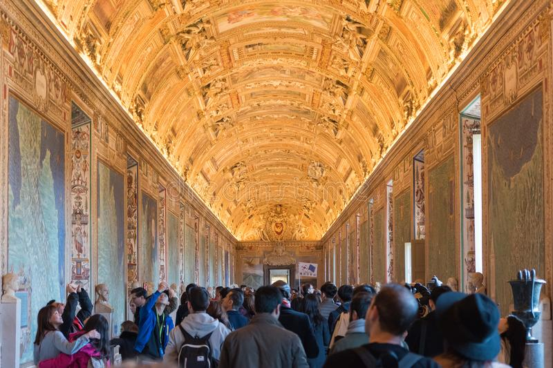 Visitors in the Sistine chapel in the Vatican museum in Vatican. VATICAN, VATICAN - DECEMBER 04, 2017: Visitors in the Sistine chapel in the Vatican museum in royalty free stock photography