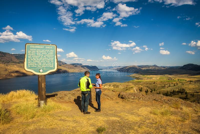 Visitors standing at the Kamloops lake in Canada royalty free stock image