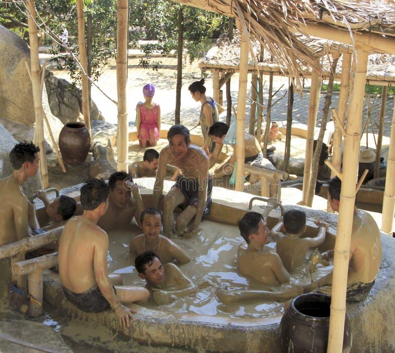 Visitors take a mud bath and have fun at I -Resort, Nha Trang, Vietnam. stock image
