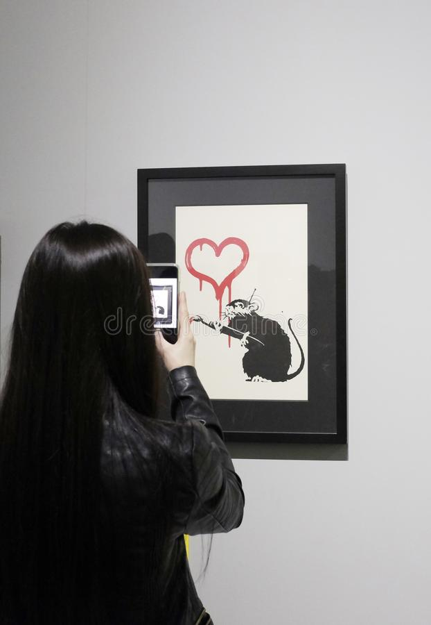 Visitors take photos in a Banksy unauthorized exhibition royalty free stock photography