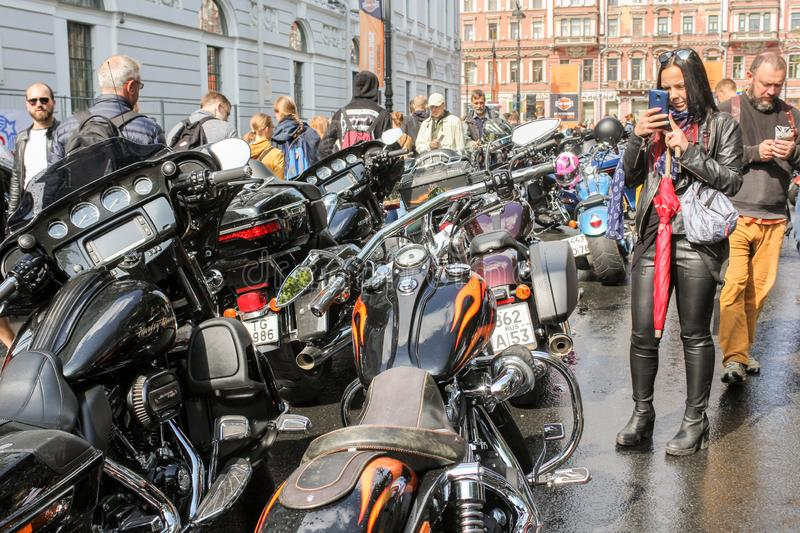 Visitors take pictures of motorcycles stock photos