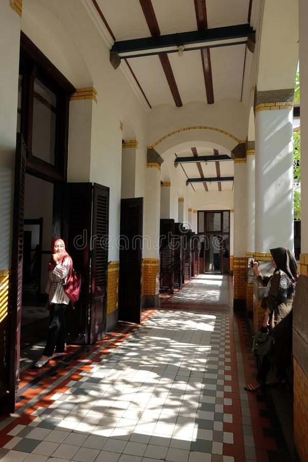 Visitors take pictures in one of the Lawang Sewu corridors. Semarang, Indonesia, 17/07/2019: Visitors take pictures in one of the Lawang Sewu corridors, a royalty free stock image