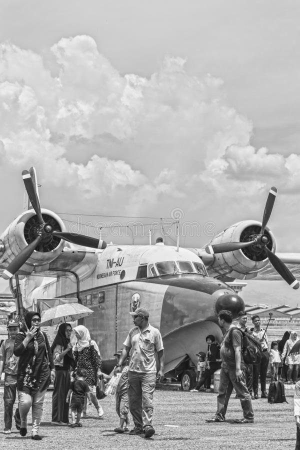 Visitors taking photo and selfie with airplane, Bandung Air Show 2017. black and white image. royalty free stock image