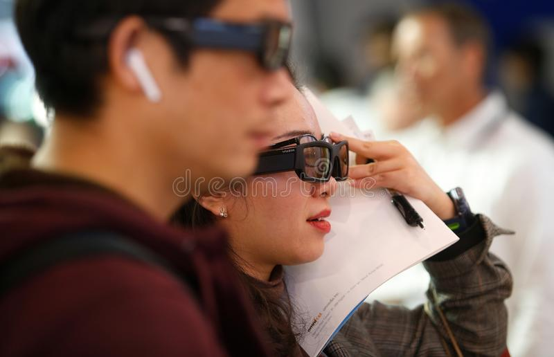 Visitors testing AR optical systems at MWC 2019 stock photo