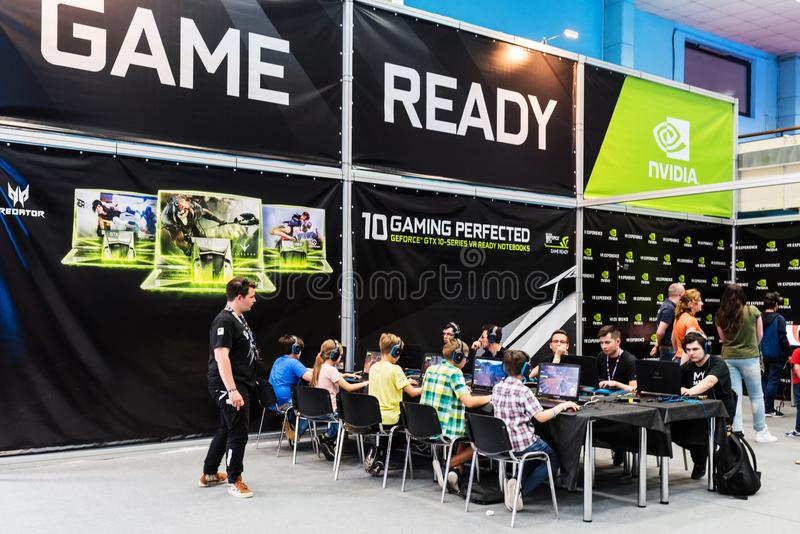 Visitors testing new games and new video boards in the Nvidia area. At East European Comic Con, 2017, in Bucharest, Romania royalty free stock photography
