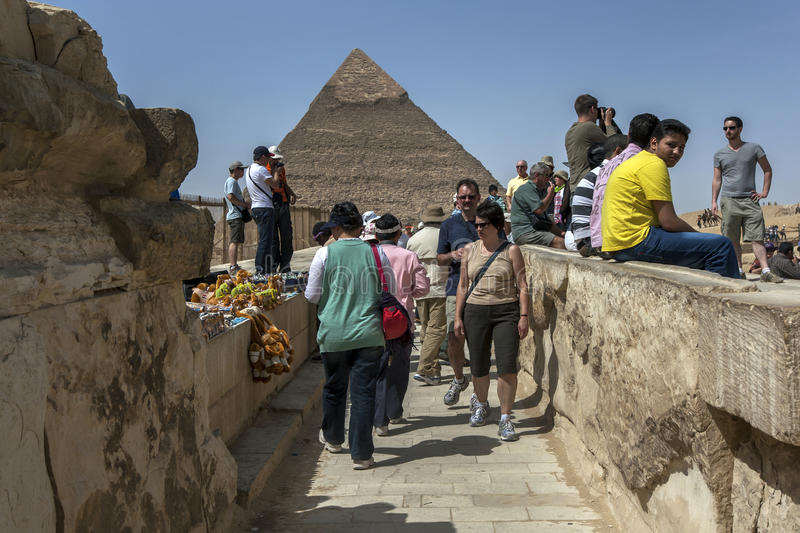 Visitors to Giza view the Pyramid of Khufu in Cairo, Egypt. This pyramid stands 136 metres high and its peak still has the original limestone casing dating to stock photography