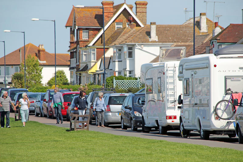Visitors to Tankerton. This photo shows visitors strolling along the green in Tankerton. This photo could be used to promote this coastal town stock image