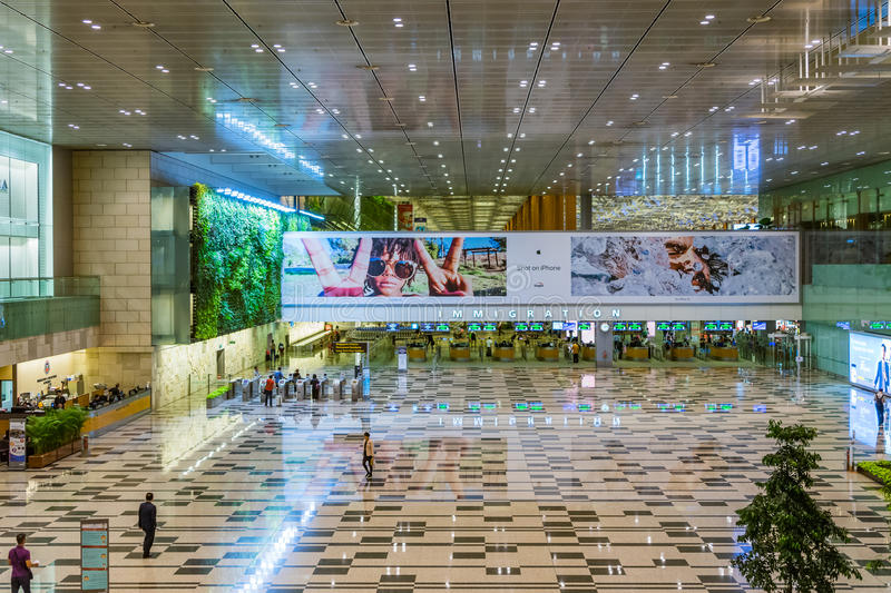 Visitors walk around Arrival Hall Immigration area in Changi Air stock photography