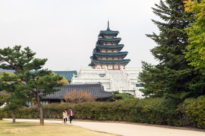 Visitors walk with the National Folk Museum of Korea in background royalty free stock photos