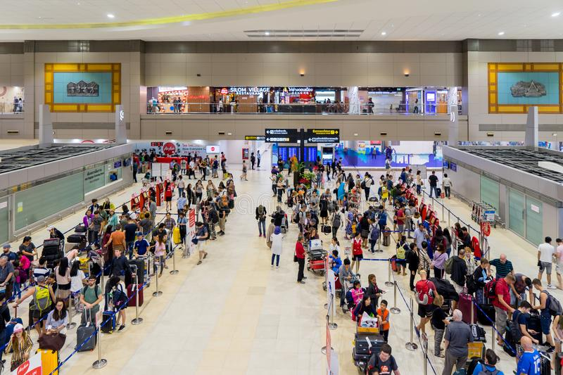 Visitors walking around Departure Hall in Don Mueang International Airport. Thailand - January 02, 2018: Visitors walking around Departure Hall in Don Mueang stock images