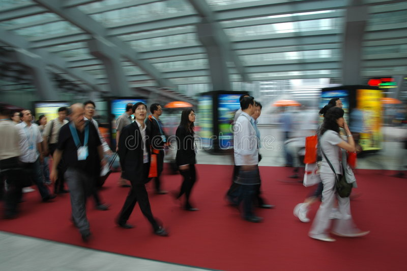 Visitors walking in the fair complex. In the 105th session of China Import and Export Fair, which is held in April 15th-May 7th,2009. It has 3 phases.(Phase1 stock image