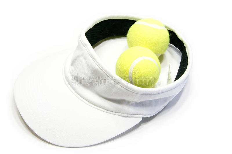 Visor cap. Picture of the white visor cap with tennis balls in white background stock image
