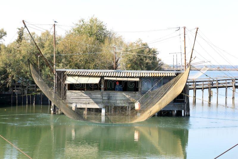 Visser in de visserij van keet, Po Delta, Italië royalty-vrije stock afbeeldingen