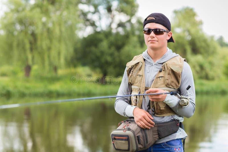 Visser op de rivierbank royalty-vrije stock foto's