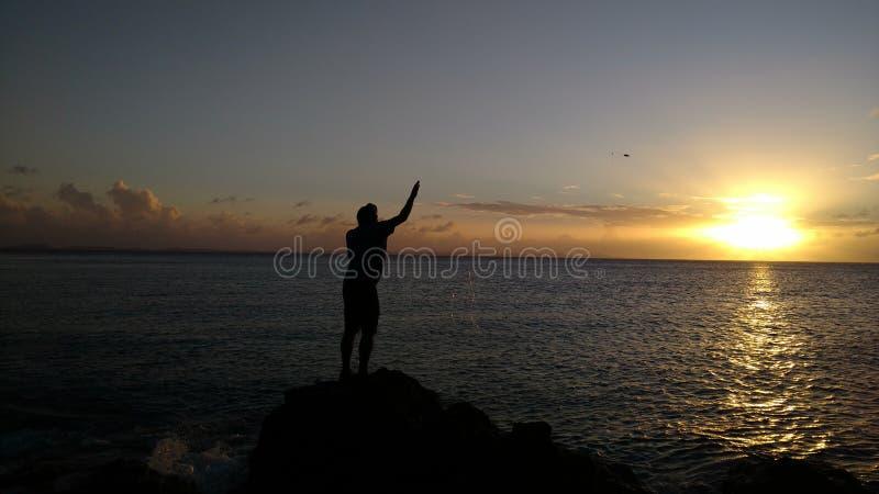 Visserij bij de Zonsondergang royalty-vrije stock foto