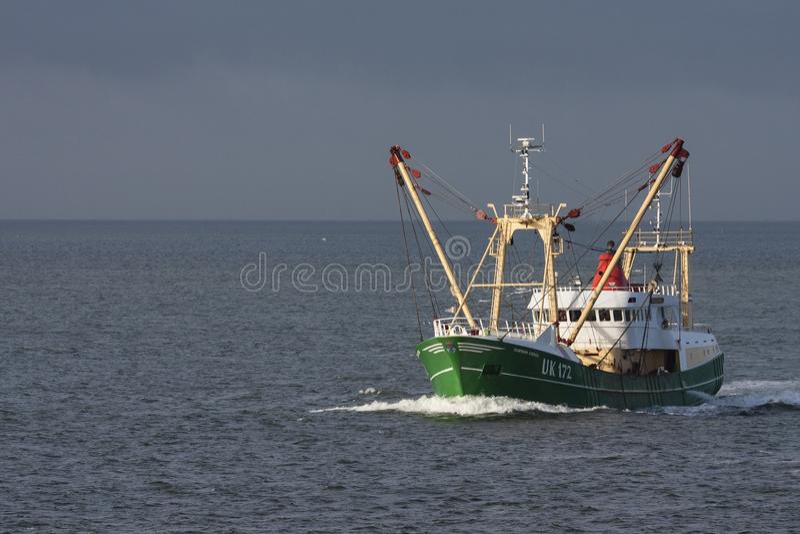 Vissersboot, Fishing Boat. Vissersboot varend op Waddenzee; Fishing Boat cruising at Wadden sea royalty free stock photography