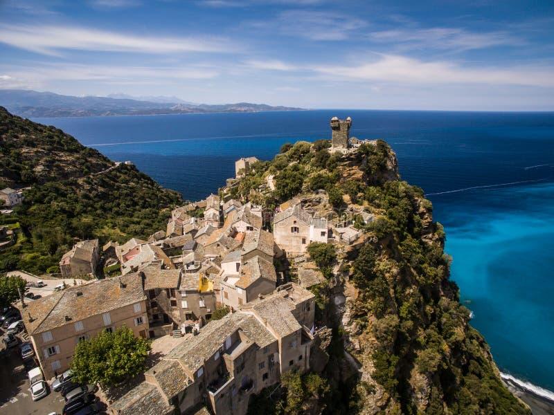 Vista aérea da vila bonita de Nonza foto de stock royalty free