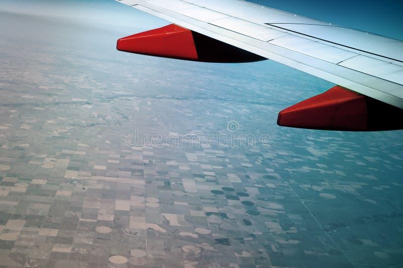 Vista aerea dalla finestra di un aeroplano fotografia stock libera da diritti