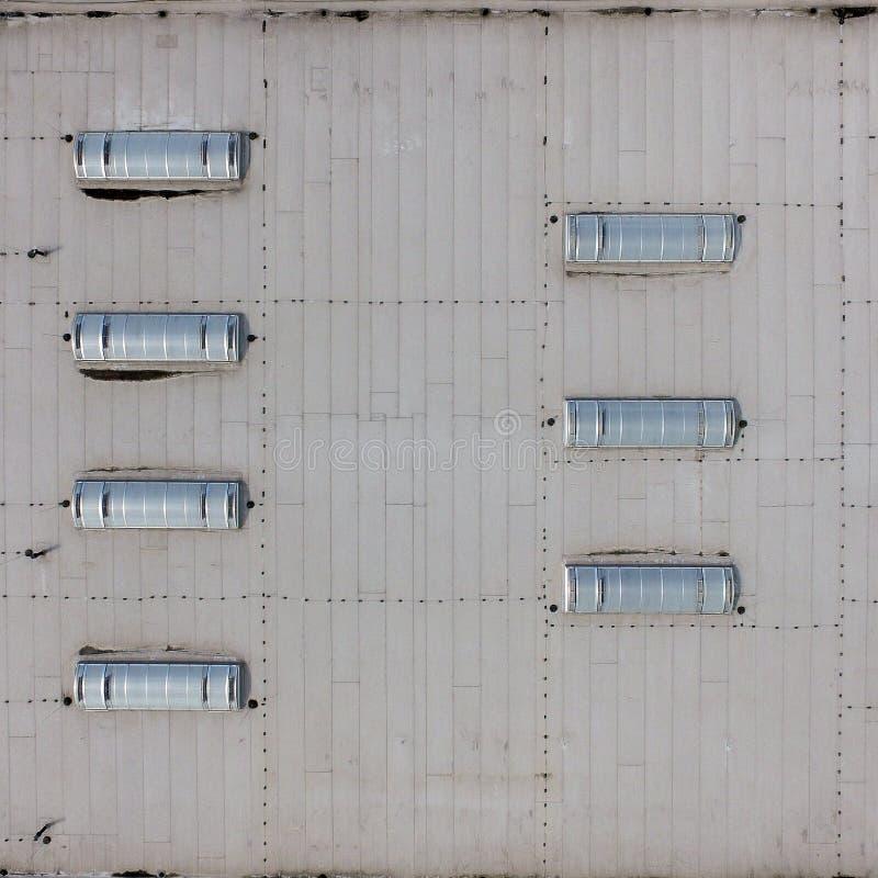 Vista aerea del tetto piano di un corridoio industriale, come fondo fotografia stock