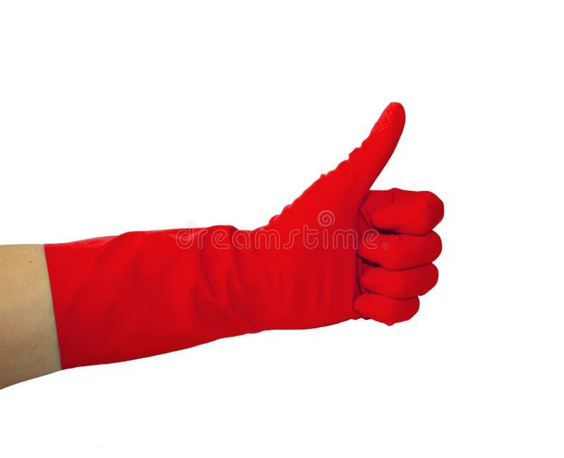 Vista ascendente cercana de la mano humana con el guante de goma que muestra la autorización o aprobar la muestra con el pulgar p foto de archivo libre de regalías